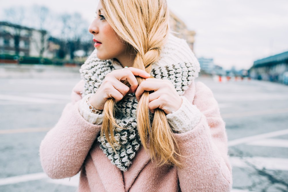 woman with blonde hair in winter